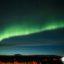 Auroras boreales en Islandia. Las luces mágicas en la isla de hielo y fuego