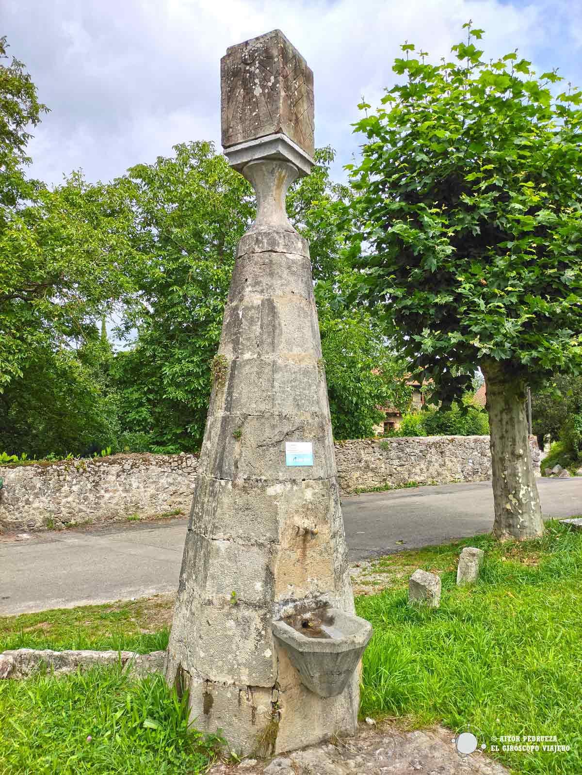 Fuente con reloj solar en Rucandio
